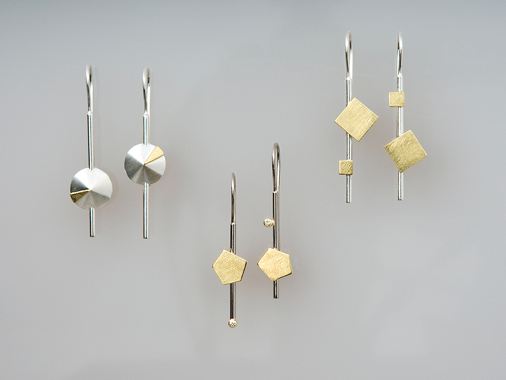 From left to right: earrings sterling silver, 18kt yellow gold; earrings white and yellow gold 18kt, diamonds 0.04ct; earrings sterling silver, 18kt yellow gold